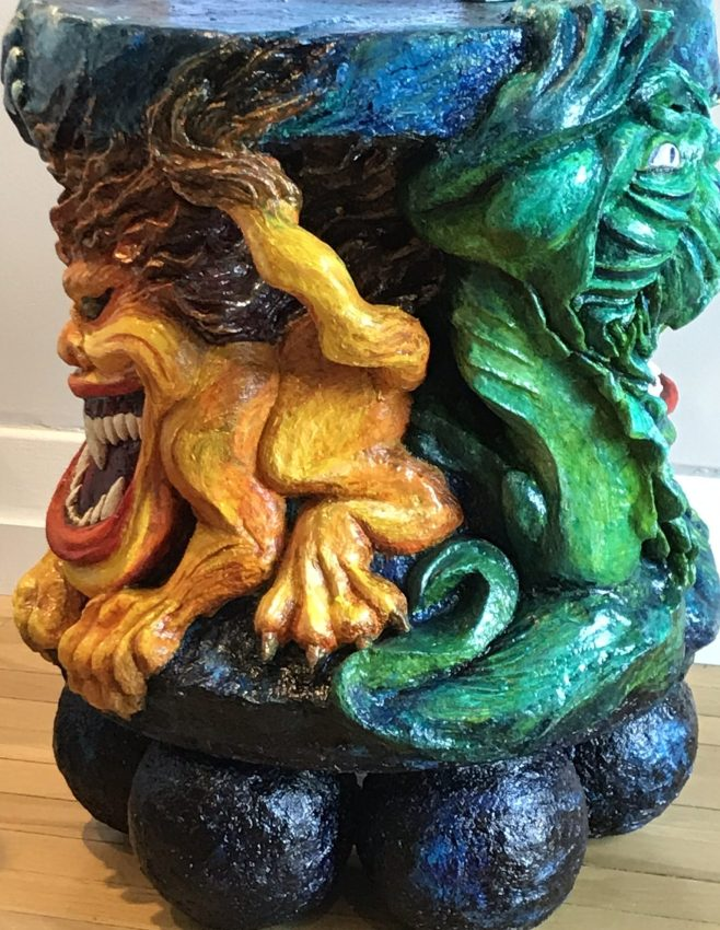 Under the Drink - a sculpted table. Fabulous beasts rising from the deep.